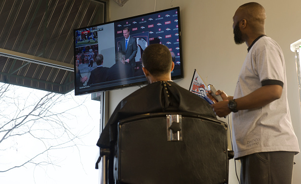 Xavier Ford gives Chris Thatch a haircut at Hollywoods Barber Shop in ...