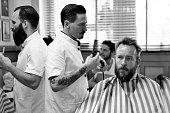 barbers with customer