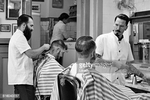 barbers working on customers