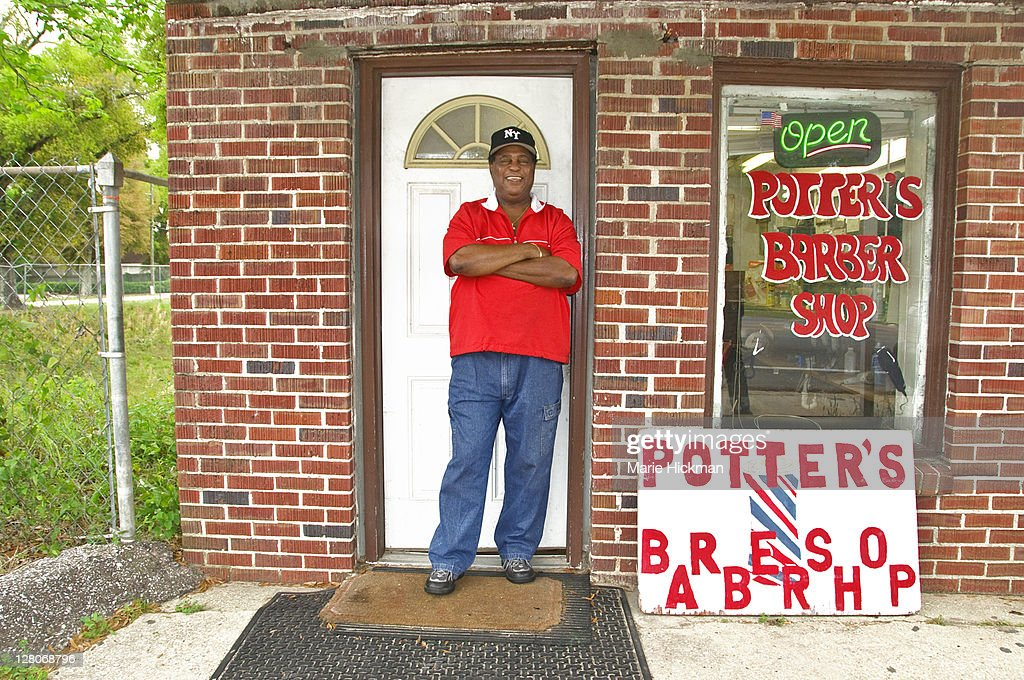 Barbershop owner in front of his own Barber Shop in Pensacola, Florida, USA : Stock Photo
