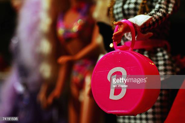 Barbie doll holds an accessory bag at Leuralla NSW toy and railway museum as the iconic doll approaches her 50th birthhday May 18 2007 in Sydney...