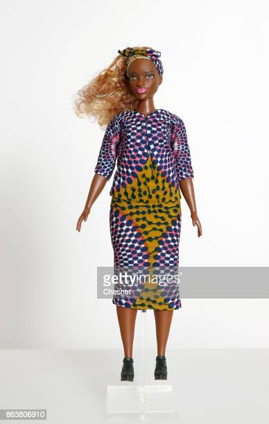 Barbie doll wearing Maison Chateau Rouge clothes is displayed during the exhibition 'Barbie Fashionistas' at Hotel Le Moliere on October 20 2017 in...