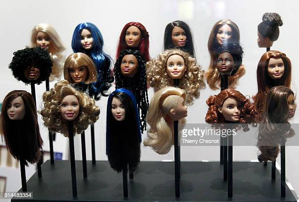 Barbie doll wigs are displayed during the exhibition 'Barbie life of an icon' at the Museum of Decorative Arts as part of the Paris Fashion Week...