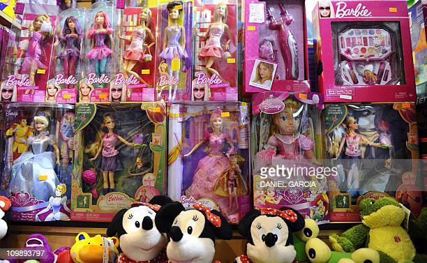 Barbie dolls are displayed at a toy store in Buenos Aires on March 9 2011 The Argentinian government limited imports Wednesday including barbie dolls...