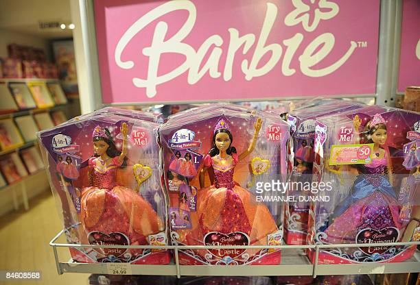 Barbie dolls stand for sale at a toy store in New York February 3 2009 Mattel the world's largest toymaker reported fourthquarter earnings that fell...