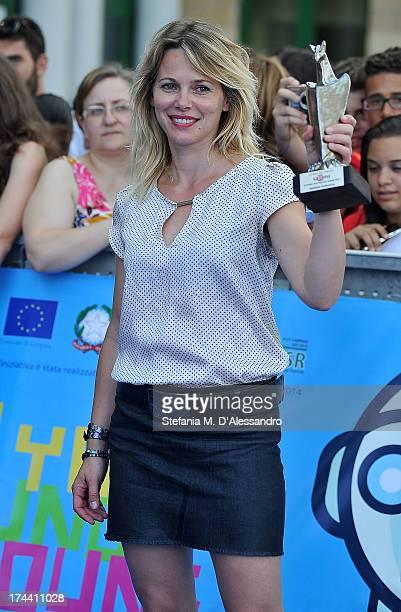 Barbora Bobulova poses with the Giffoni Award during 2013 Giffoni Film Festival photocall on July 25 2013 in Giffoni Valle Piana Italy