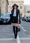 Barbora Ondrackova wearing a black Topshop hat white Zara blouse Missguided â cape Topshop skirt Chloe bag Stuart Weitzman boots seen outside during...