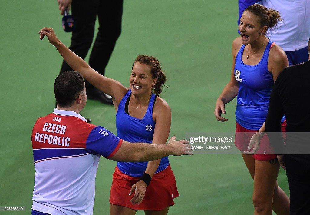 Barbora Strycova (C) and Karolina Plyskova (R) of Czech tennis double team celebrate after the FedCup World Cup first round tennis match at 'Sala Polivalenta Cluj Napoca' hall in Cluj Napoca city February 7, 2015. / AFP / DANIEL MIHAILESCU