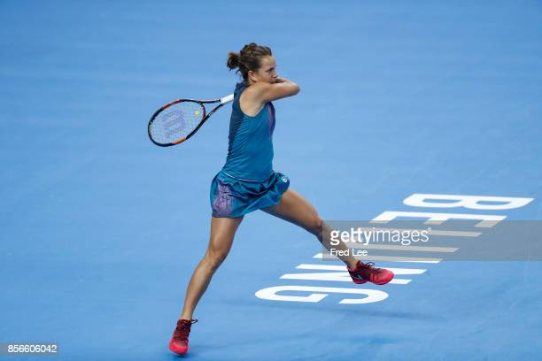 Barbora Strycova of Czech Republic returns a shot against Garbine Muguruza of Spain on day three of the 2017 China Open at the China National Tennis...