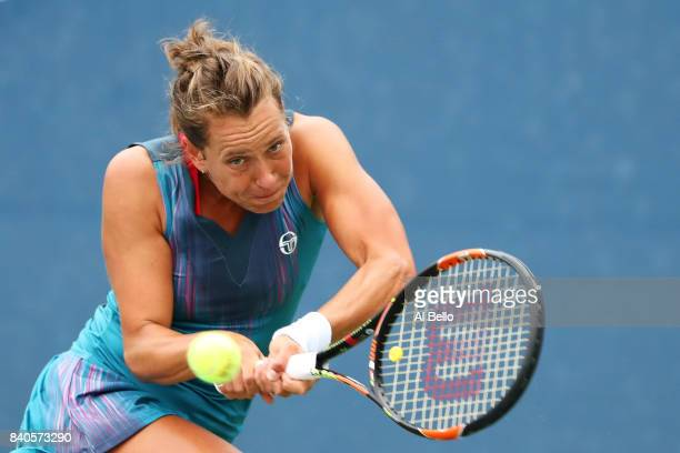 Barbora Strycova of Czech Republic returns a shot Misaki Doi of Japan during their first round Women's Singles match on Day Two of the 2017 US Open...