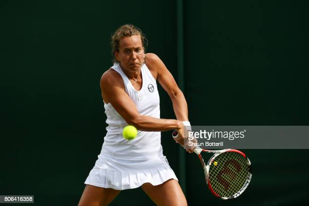 Barbora Strycova of the Czech Republic plays a backhand during the Ladies Singles first round match against Veronica Cepede Royg of Paraguay on day...