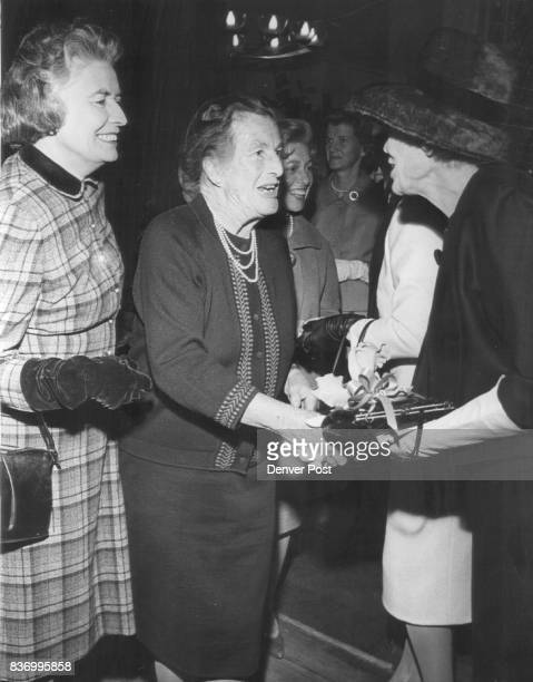 Barbour Alexander Mrs Committee woman meet for Tea Mrs Donald Goodhart left Mrs Alexander Barbour center are greeted by Mrs William E Sweet Jr...