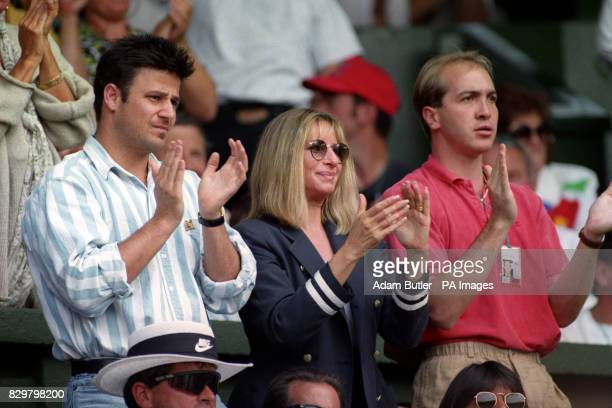 Barbra Streisand APPLAUDS ANDRE AGASSI ALONG WITH HIS BROTHER PHILLIP AND AN UNIDENTIFIED MAN DURING AGASSI'S QUARTER FINAL AGAINST PETE SAMPRAS
