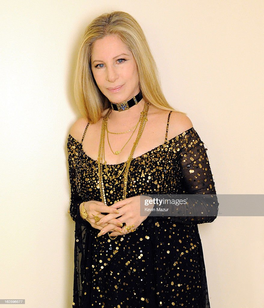 Barbra Streisand poses backstage at the 85th Annual Academy Awards at the Dolby Theatre on February 24, 2013 in Hollywood, California. The Donna Karan New York gown worn by Barbra Streisand in her performance at the 85th Annual Academy awards was designed by Ms. Karan, specifically for the artist. Entitled 'City Lights' the black asymmetrical, bias-cut dress is a waterfall of chiffon layers encrusted with matte gold sequins and beads. A long-sleeve capelet adds the final layer of chiffon, its back dramatically falling to the floor. 'Everything I do with Barbra is a collaboration(degrees)? born of our artistry, our friendship and our love for one another. We're sisters.' Donna Karan