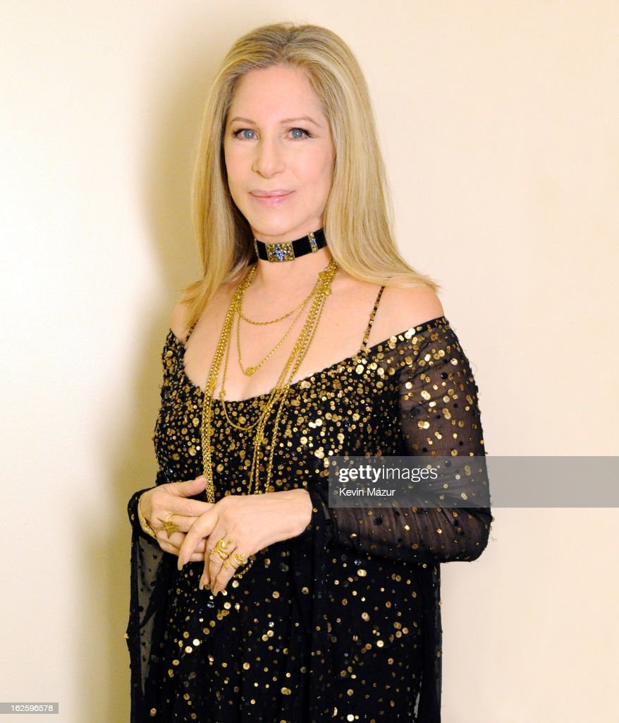 Barbra Streisand poses backstage at the 85th Annual Academy Awards at the Dolby Theatre on February 24, 2013 in Hollywood, California. The Donna Karan New York gown worn by Barbra Streisand in her performance at the 85th Annual Academy awards was designed by Ms. Karan, specifically for the artist. Entitled 'City Lights' the black asymmetrical, bias-cut dress is a waterfall of chiffon layers encrusted with matte gold sequins and beads. A long-sleeve capelet adds the final layer of chiffon, its back dramatically falling to the floor. 'Everything I do with Barbra is a collaboration(degrees)© born of our artistry, our friendship and our love for one another. We're sisters.' Donna Karan