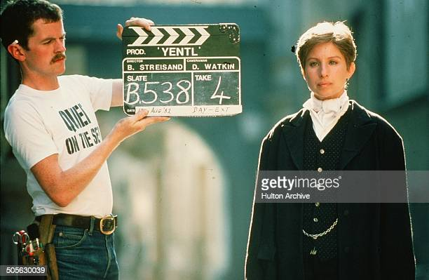 Barbra Streisand stands ready to start a scene in the movie 'Yentl' circa 1983