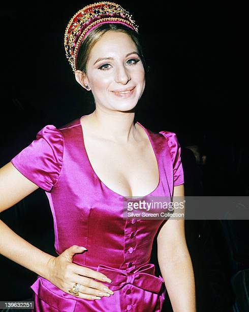 Barbra Streisand US actress and singer wearing a fuchsia pink silk dress with a scoop neckline and a matching bow around the waist circa 1965