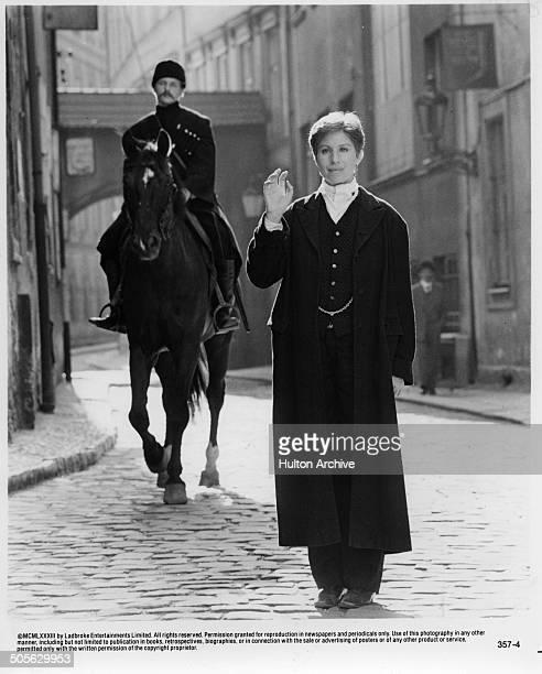 Barbra Streisand walks down a street in a scene in the movie 'Yentl' circa 1983