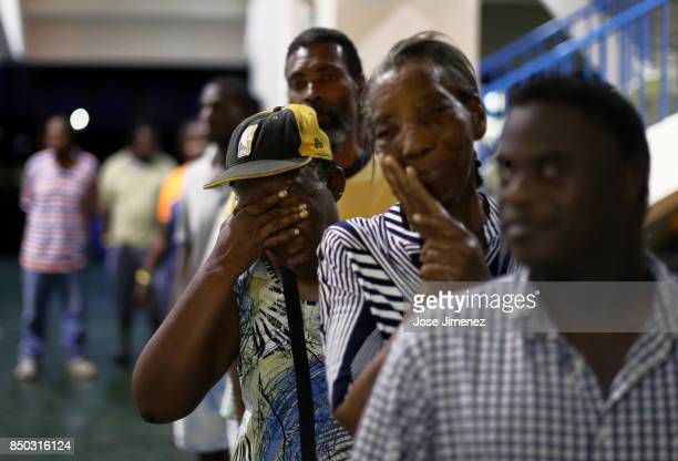 Barbuda resident Diamn Beazer waits for food at a shelter in the Sir Vivian Richards Cricket Stadium on September 20 2017 in North Sound Antigua and...