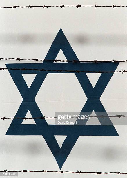 Barbwire At The Auschwitz Concentration Camp In Southern Poland Cuts Across An Israeli Flag Wednesday April 22 1998 A Day Before Prime Minister...