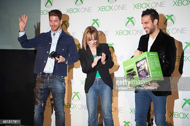 Barca football palyer Cesc Fabregas and Real Madrid football player Sergio Ramos play video games on the new Xbox One during the Presentation of New...