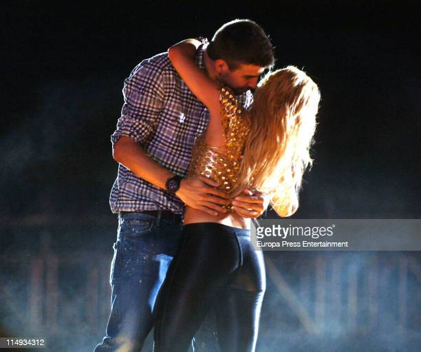 Barca Football player Gerard Pique goes on stage in Shakira's concert at the Lluis Campanys Olympic Stadium on May 29 2011 in Barcelona Spain