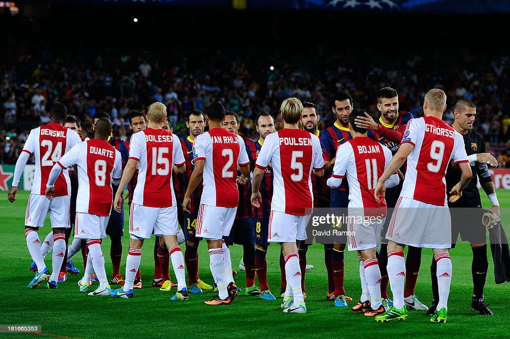 FC Barcelona and Ajax Amsterdam players shake hands prior to the UEFA Champions League Group H match between FC Barcelona and Ajax Amsterdam at the Camp Nou stadium on September 18, 2013 in Barcelona, Spain.