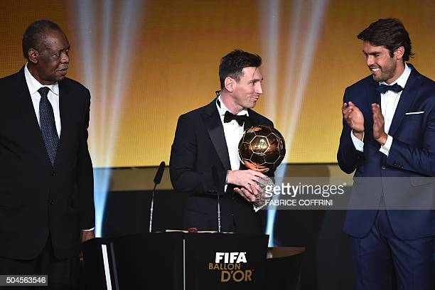 FC Barcelona and Argentina's forward Lionel Messi holds his trophy flanked by FIFA interim president Issa Hayatou and Brazil and Orlando City...