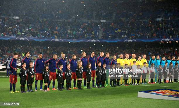 Barcelona and Arsenal players line up for the match