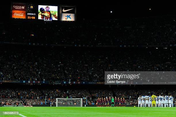 Barcelona and RCD Espanyol players observe a minute of silence of goalkeeper Nil Marin of Girona 'B' during the La Liga match between FC Barcelona...