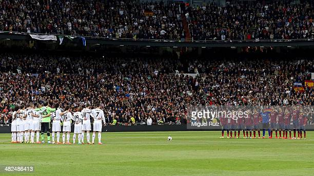 Barcelona and Real Madrid CF teams observe a minute of silence during La Liga match 29 between Real Madrid CF and FC Barcelona at Bernabeu on March...