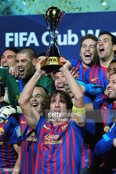 Barcelona captain Carles Puyol lifts the trophy after the FIFA Club World Cup Final match between Santos and Barcelona at the Yokohama International...