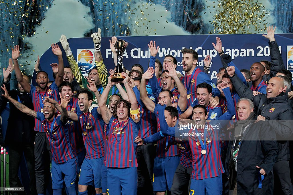 Barcelona captain <a gi-track='captionPersonalityLinkClicked' href=/galleries/search?phrase=Carles+Puyol&family=editorial&specificpeople=211383 ng-click='$event.stopPropagation()'>Carles Puyol</a> (4L) lifts the trophy amongst team-mates celebrating after the FIFA Club World Cup Final match between Santosl and Barcelona at the Yokohama International Stadium on December 18, 2011 in Yokohama, Japan.
