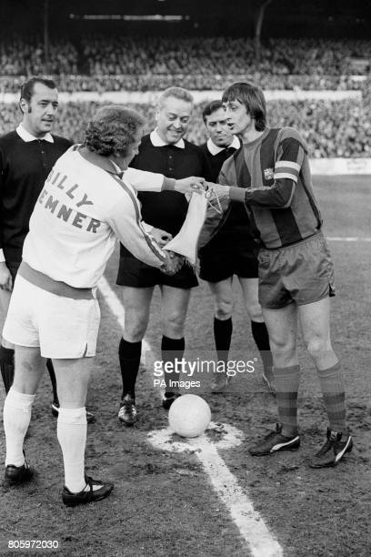 Barcelona captain Johan Cruyff right swaps pennants with Leeds captain Billy Bremner before the start of the match
