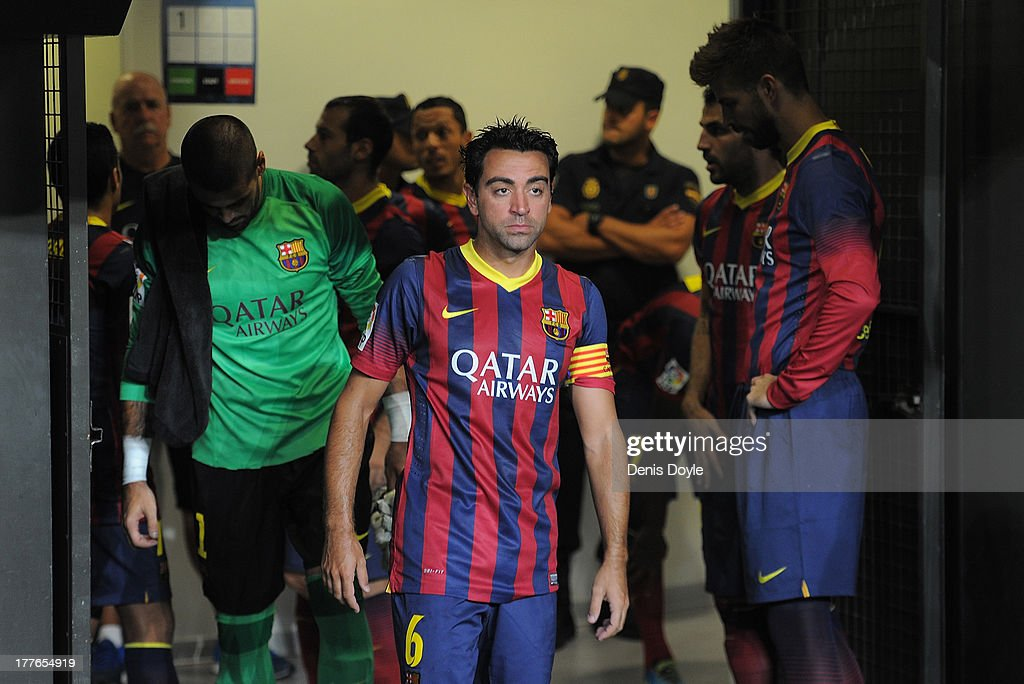 FC Barcelona captain Xavi Hernandez gets reads to lead his team out for the start of the La Liga match between Malaga CF and FC Barcelona at La Rosaleda Stadium on August 25, 2013 in Malaga, Spain.