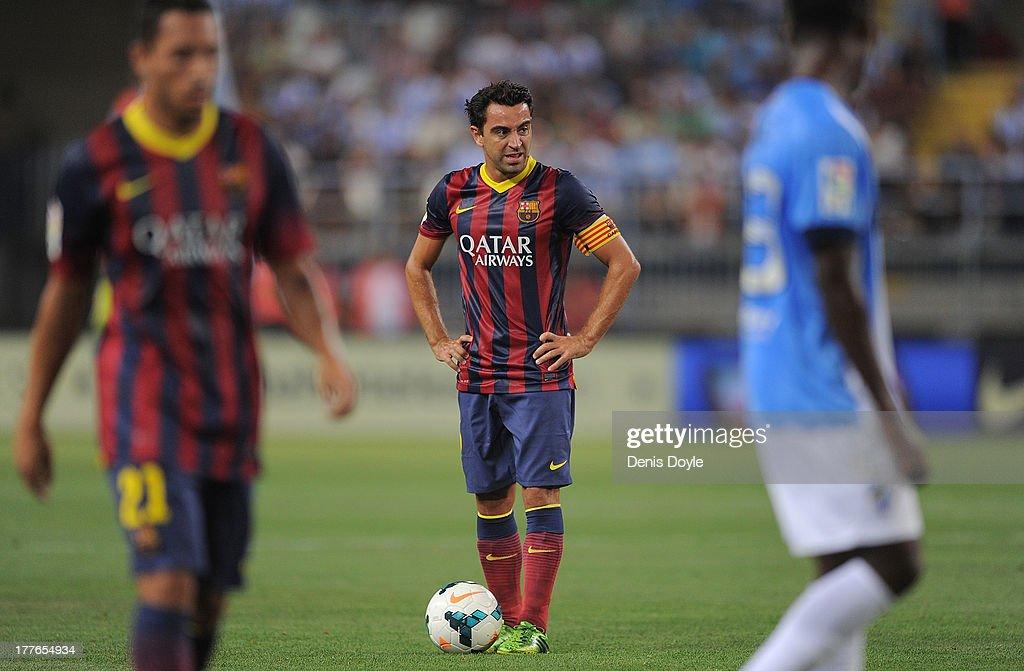 FC Barcelona captain Xavi Hernandez gets ready to take a free kick during the La Liga match between Malaga CF and FC Barcelona at La Rosaleda Stadium on August 25, 2013 in Malaga, Spain.