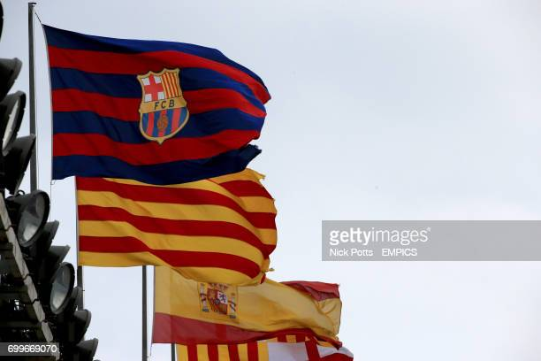 Barcelona Catalan and Spain flags fly above the Camp Nou