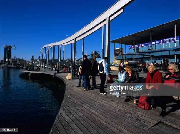 Barcelona Cataluna Rambla de Mar People siting in a bench