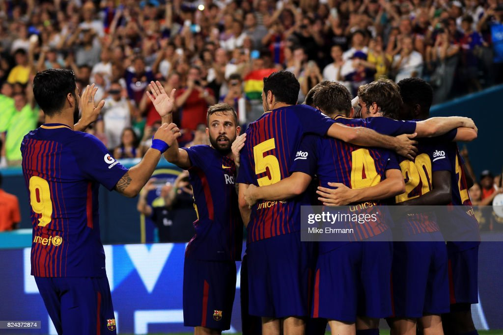 Barcelona celebrate a goal in the second half against Real Madrid during their International Champions Cup 2017 match at Hard Rock Stadium on July 29, 2017 in Miami Gardens, Florida.