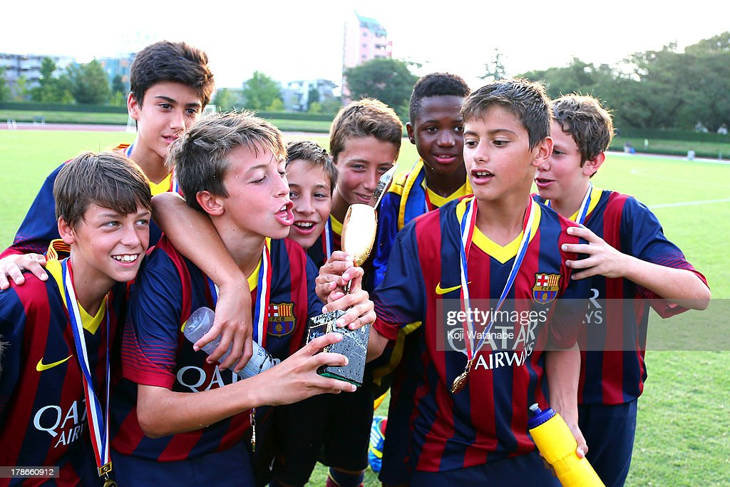 FC Barcelona celebrate during the U-12 Junior Soccer World Challenge 2013 final match between FC Barcelona and Liverpool FC at Ajinomoto Stadium on August 30, 2013 in Tokyo, Japan.