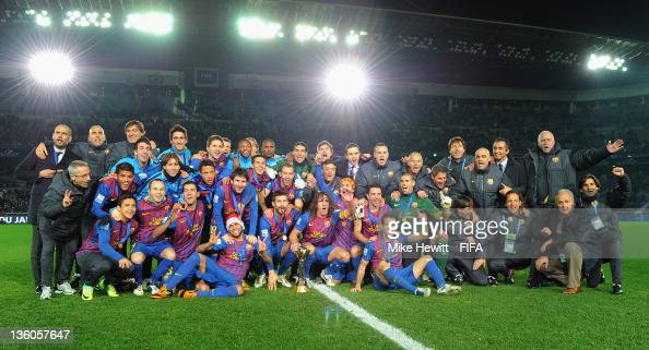 Barcelona celebrate victory in the FIFA Club World Cup Final match between Santos and FC Barcelona at the International Yokohama Stadium on December...