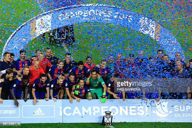 FC Barcelona celebrate with the trophy after winning the second leg of the Spanish Supercup football match between FC Barcelona and Sevilla FC at the...