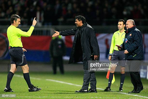 Barcelona coach Frank Rijkaard is sent out by referee Stefano Farina during the champions league soccer match between Olympique Lyonnais and FC...
