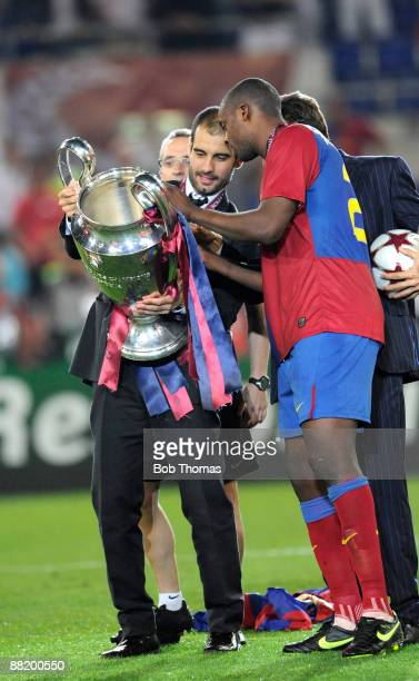 Barcelona coach Josep Guardiola holds the trophy with Yaya Toure after the UEFA Champions League Final match between Barcelona and Manchester United...