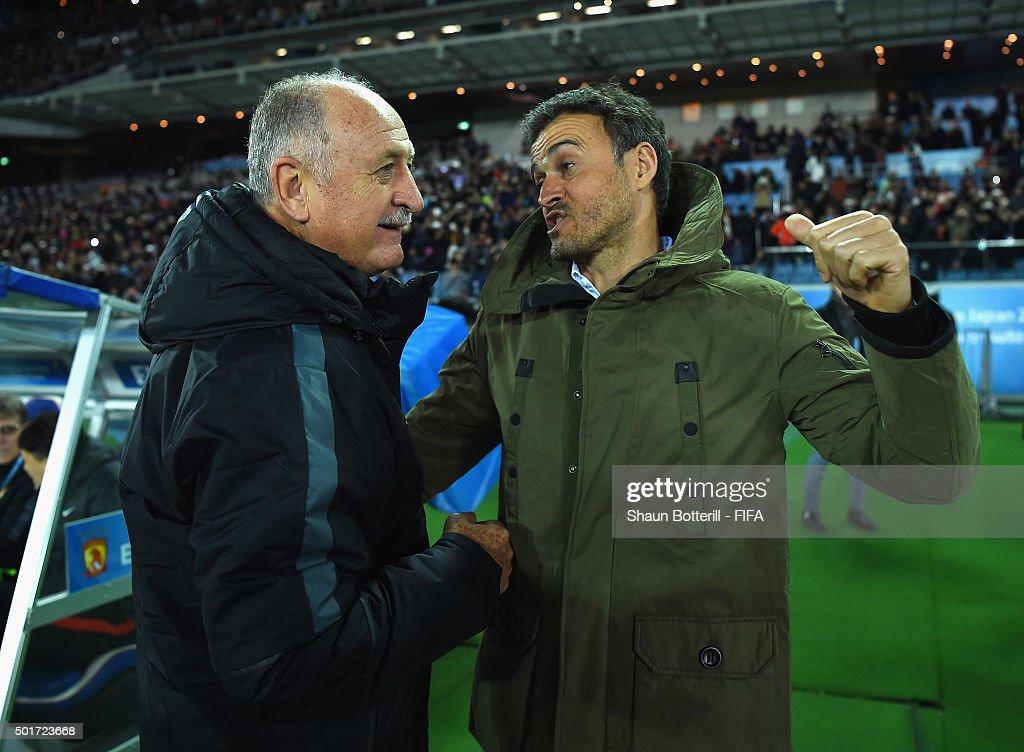 Barcelona coach Luis Enrique and Guangzhou Evergrande FC coach Luiz Felipe Scolari meet before the FIFA Club World Cup Semi Final match between...
