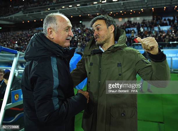 Barcelona coach Luis Enrique and Guangzhou Evergrande FC coach Luiz Felipe Scolari meet before the FIFA Club World Cup Semi Final match between...
