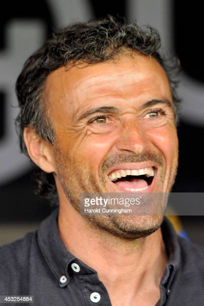 Barcelona Coach Luis Enrique Martinez laughs prior to the preseason friendly match between FC Barcelona and SSC Napoli on August 6 2014 in Geneva...