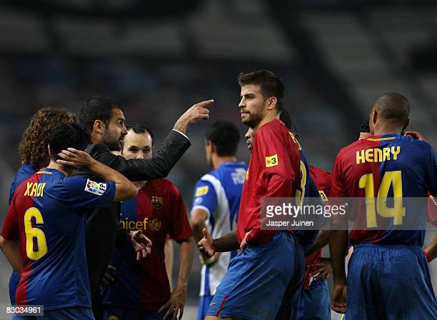 Barcelona coach Pep Guardiola of Barcelona instructs his players during the temporary stop due to supporters trouble during the La Liga match between...