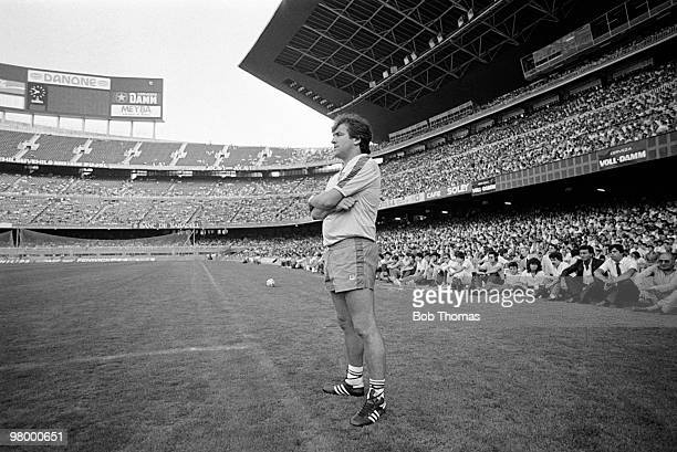 Barcelona coach Terry Venables watching his first training session in The Nou Camp Stadium in turn watched by over 35000 football fans on 27th July...
