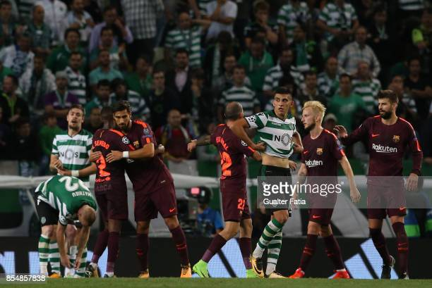 Barcelona defender Nelson Semedo from Portugal and Barcelona midfielder Andre Gomes from Portugal celebrate the victory at the end of the UEFA...